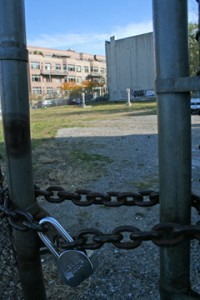 The locked gate at the empty lot on Sackett and Fourth, which will someday be a GreenSpace garden.