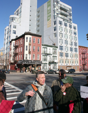 Walkers talked about street-level retail in front of the Argyle on Fourth Avenue.